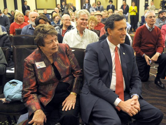 Rick Santorum and presidential hopeful sits with Sandra