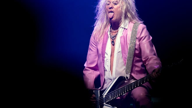 Rick Savage of Def Leppard at Thompson-Boling Arena.