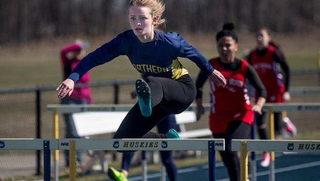 Port Huron Northern sophomore Jenevieve Peyerk, 15, competes in the 100-meter hurdles during a track meet Thursday, April 14, 2016 at Port Huron Northern High School.