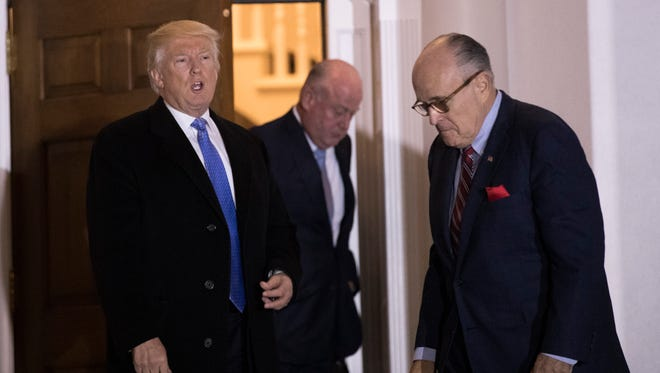 BEDMINSTER TOWNSHIP, NJ - NOVEMBER 20: (L to R) President-elect Donald Trump and former New York City mayor Rudy Giuliani exit the clubhouse following their meeting at Trump International Golf Club, November 20, 2016 in Bedminster Township, New Jersey. Trump and his transition team are in the process of filling cabinet and other high level positions for the new administration.  (Photo by Drew Angerer/Getty Images)