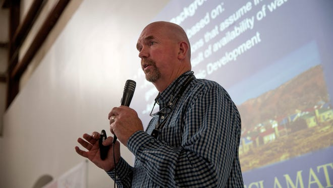 Pat Page, deputy construction engineer with the U.S. Bureau of Reclamation, delivers a presentation on the Navajo-Gallup Water Supply Project Aug. 8 at the Tsé Alnaozt'i'í Veteran Memorial Building in Sanostee.