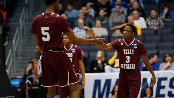 March 14, 2018; Dayton, OH, USA; Texas Southern Tigers center Trayvon Reed (5) celebrates a play with guard Demontrae Jefferson (3) in the first half against the North Carolina Central Eagles during the First Four of the 2018 NCAA Tournament at Dayton Arena. Mandatory Credit: Rick Osentoski-USA TODAY Sports