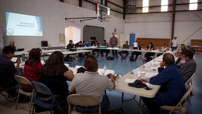 Community members listen at a public hearing for the Navajo-Gallup Water Supply Project on Aug. 8 at the Tsé Alnaozt'i'í Veteran Memorial Building in Sanostee.