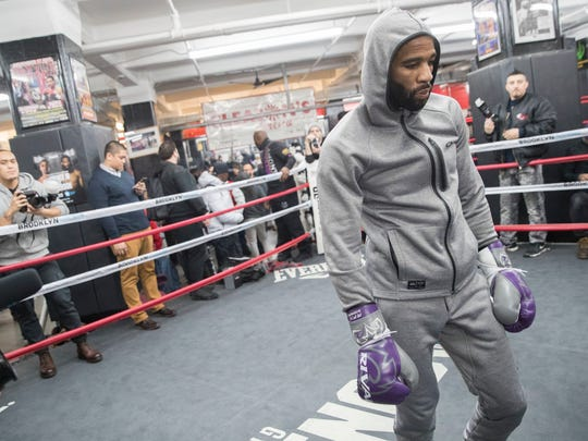 Lamont Peterson walks in the ring during a workout at Gleason's Gym, Wednesday, Jan. 17, 2018, in the Brooklyn borough of New York. Peterson faces Errol Spence Jr. on Saturday in Brooklyn, for Spence's IBF welterweight title. (AP Photo/Mary Altaffer)