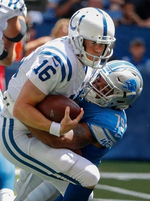 Indianapolis Colts quarterback Scott Tolzien (16) is sacked by Detroit Lions defensive end Alex Barrett (79) in the first half of their preseason NFL football game at Lucas Oil Stadium Sunday afternoon, August 13, 2017.