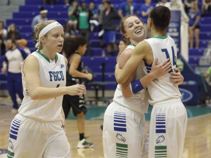 FGCU's Whitney Knight and Katie Meador hug after defeating USC Upstate at Alico Arena on Saturday night.