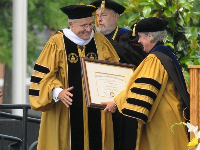 Rudolph Giuliani is awarded an Honorary Doctor of Humane Letters degree by USM President Dr. Martha  Saunders  during the Centennial Celebration Commencement at the University of Southern Mississippi. Approximately 1,600 graduates received degrees during the ceremony.