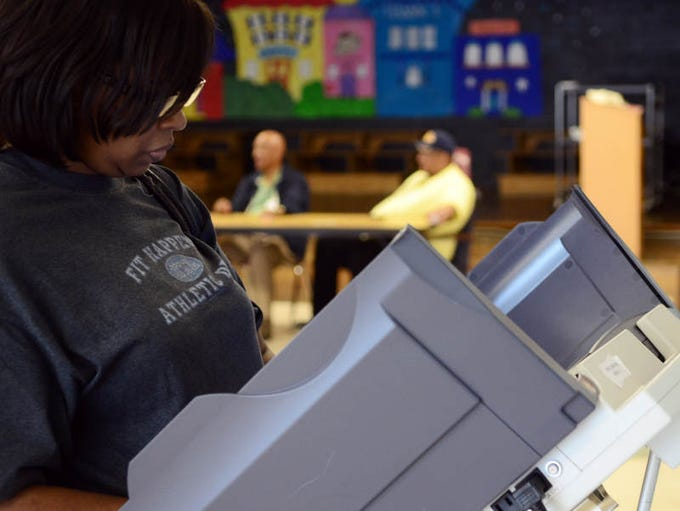 Felisha McSwain votes at Grace Christian Elementary School on Tuesday during Hattiesburg's municipal elections.