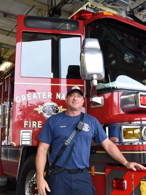 Capt. Craig Weinbaum poses in front of a fire truck at Greater Naples Fire Rescue District on July 11, 2017.