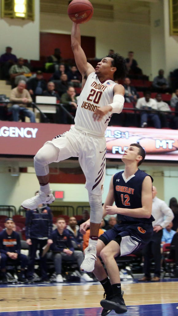 Mount Vernon's Jason Douglas-Stanley (20) drives to the basket in front of Greeley's Gregory Karr (12) during the boys Section 1 semifinal at the Westchester County Center in White Plains Feb. 28, 2018.