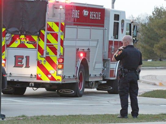 A Sheboygan police officer radios back to dispatch