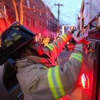 Wilmington firefighter Glenn Milton gears up as a call comes in for a residential fire on Madison and 8th Street in 2013.  Fire department overtime spending has more than doubled the amount spent two years ago, despite efforts to keep costs low.