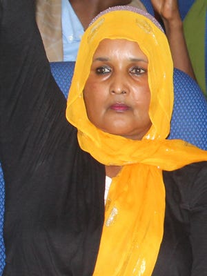 In this photo taken Dec. 2, 2013, Saado Ali Warsame, a Somali member of parliament, is seen during a parliament session. Warsame, who also was a popular singer of Somali folk music, was shot dead by gunmen who pulled up near her car as she was being driven to a hotel, said Somali police Capt. Mohamed Hussein.