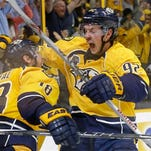 Nashville Predators center Ryan Johansen (92) celebrates with left wing James Neal (18) after Neal scored against the Anaheim Ducks in the second period of Game 6 in an NHL hockey first-round Stanley Cup playoff series Monday, April 25, 2016, in Nashville, Tenn. The Predators won 3-1 to even the series 3-3. (AP Photo/Mark Humphrey)