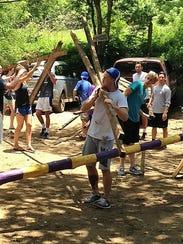 Students volunteering at The Monkey Farm, a monkey