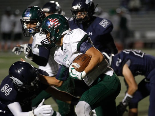 Rio Rancho's Isaiah Chavez carries the ball against