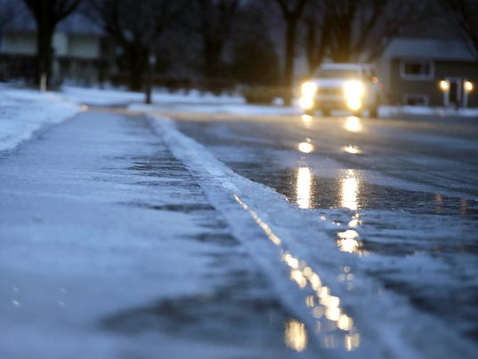 freezing downpour covers wisconsin roads with ice