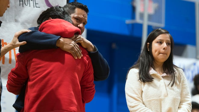 Raul, left, is comforted after speaking publicly about his mother's detainment by ICE. Raul and Beatriz, right, both talked about the impact of having family members detained during a prayer vigil on Monday, April 9, 2018 at Hillcrest Elementary School in Morristown, TN.