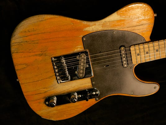 Bruce Springsteen in '108 Rock Star Guitars'