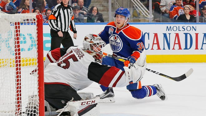 Feb 14, 2017: Arizona Coyotes goaltender Louis Domingue (35) makes a save on Edmonton Oilers forward Drake Caggiula (36) during the second period at Rogers Place.