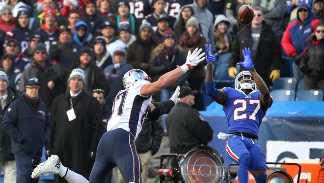 Bills Tre'Davious White fights for position with Patriots Rob Gronkowski.  White came up with the interception on the play but was also injured.  Gronkowski was penalized for the unsportsmanlike conduct on the play.