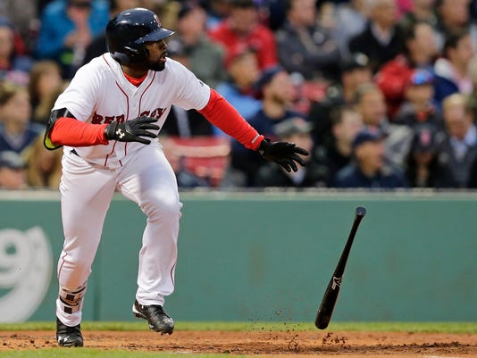 Boston Red Sox's Jackie Bradley Jr. tosses the bat after hitting a double during the second inning of a baseball game against the Colorado Rockies in Boston, Tuesday, May 24, 2016. With the hit, Bradley extended his hitting streak to 28 games. (AP Photo/Charles Krupa)