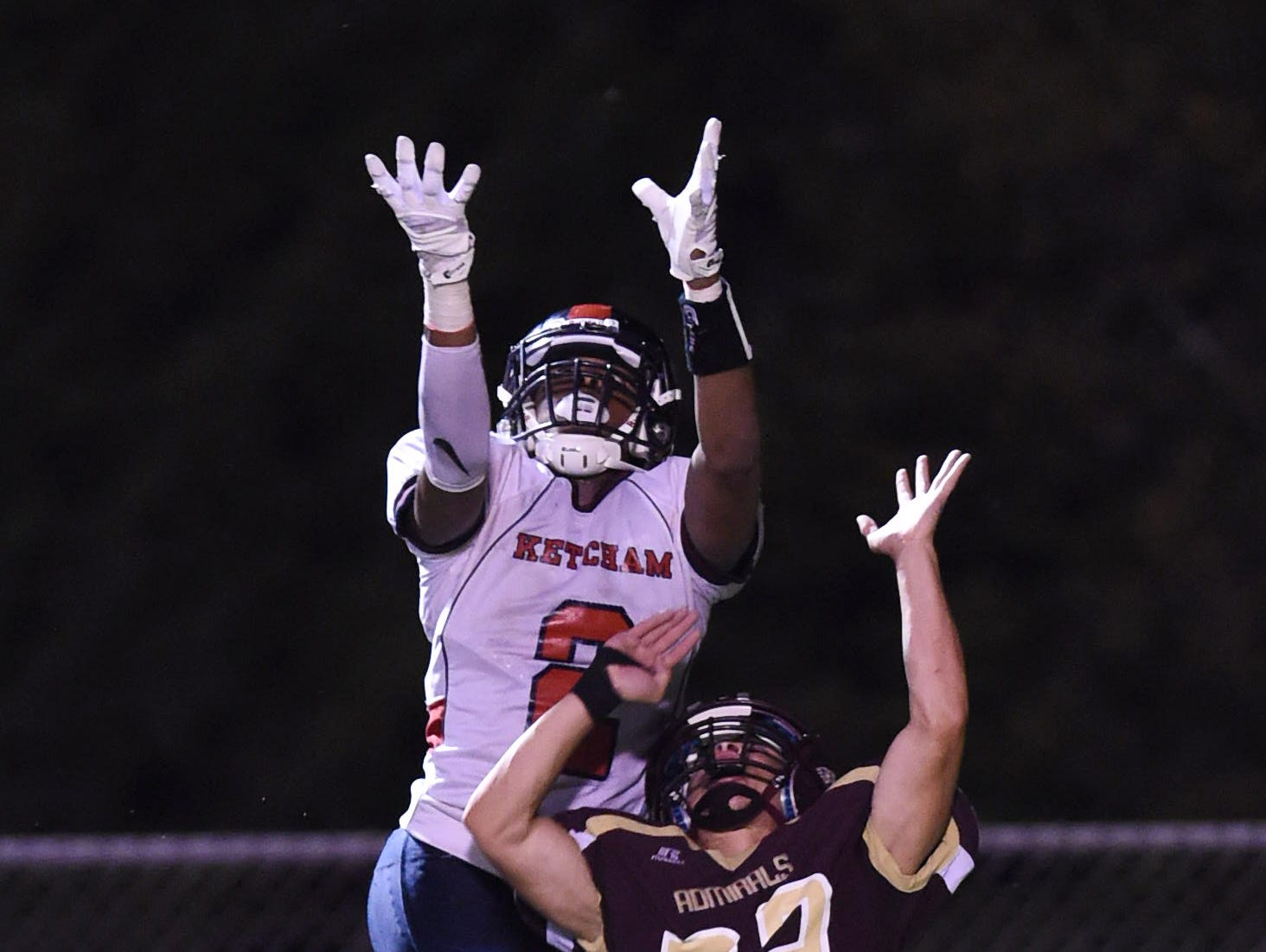 Zaahir Woody leaps to make a catch in the Roy C. Ketcham High School football team's game against Arlington on Sept. 9.