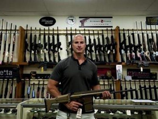 Wes Morosky, president and owner of Duke's Sport Shop, poses for a portrait with a Scar FNH 308 caliber semi-automatic rifle, which is one of the many rifles that could be used for hunting if House Bill 2333 passes, allowing use of AR 15-style guns into the woods. Currently 48 states in the United States allow semiautomatic rifles for the use of hunting.
