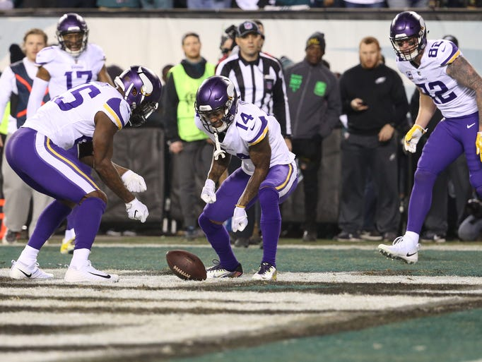 The Minnesota Vikings' Stefon Diggs (14) and Latavius