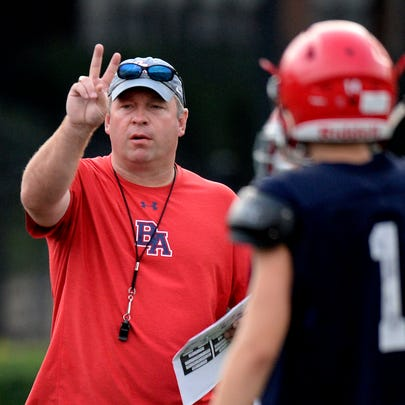 Brentwood Academy head coach Cody White calls a play