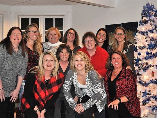 Season Kickoff - A few members of the St Vincent Medical Group Cardiology department gathered for cocktails, games and a gift exchange at Ashley Hammer's McCutchanville home to kick off the Christmas season. Pictured from left (back) are Kendra Grimm, Crystal Hudson, Paige Hall, Becky Schmidt, Kris Akers, Shay Martin, and Kacy Jones. Front row from left are Ashley Hammer, Lori Reuter, Kara Falls and Shaleen Ayers.