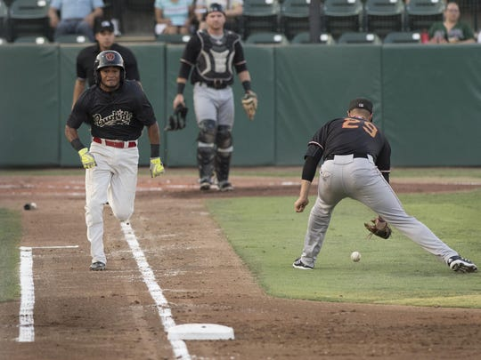 Visalia Rawhide's Robelys Reyes gets to first as Modesto's Collin Ferguson tries to make the play in the third of a three-game series on Wednesday, July 27, 2016.
