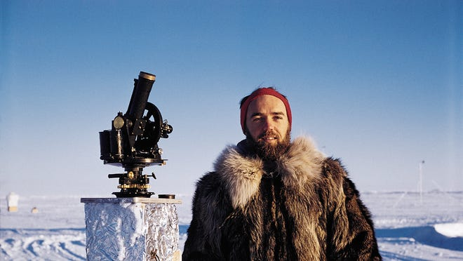 Ken Hunkins, pictured in 1957 in the Arctic on Ice Station Alpha, with navigational equipment.