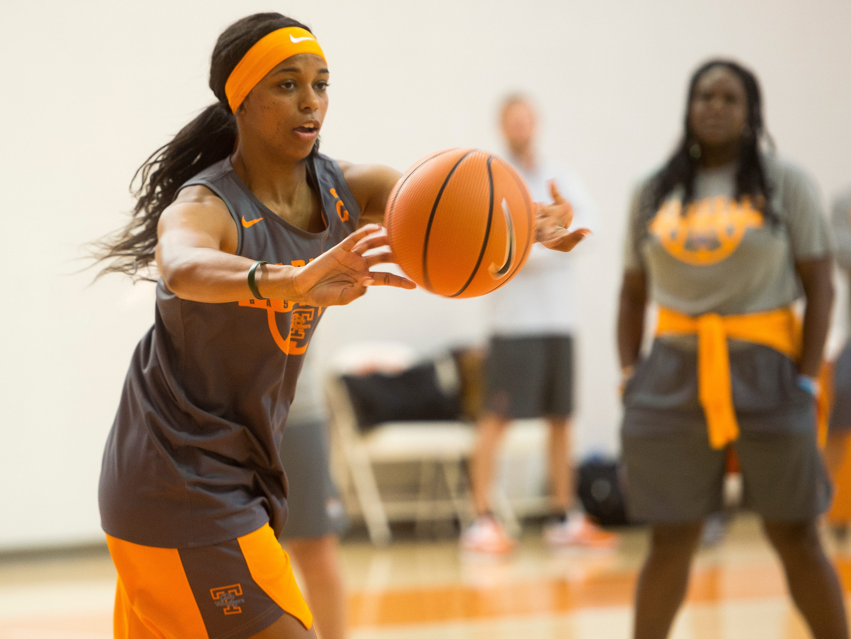 Tennessee guard Evina Westbrook (2) passes the ball off to a teammate during the Lady Vols first official preseason practice at Pratt Pavilion on Tuesday, Oct. 3, 2017.
