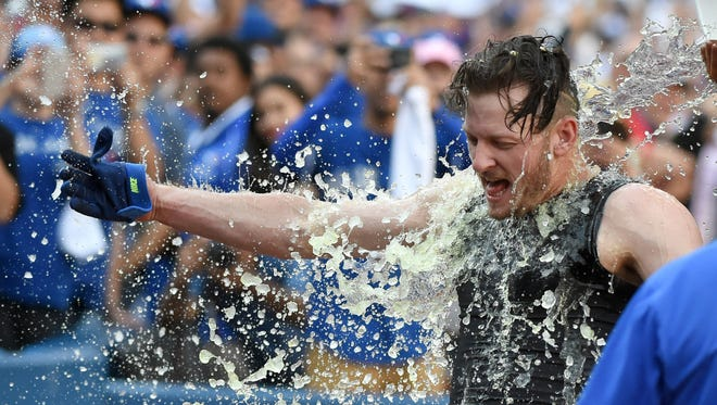 Blue Jays third baseman Josh Donaldson reacts as he is doused with ice water after hitting a game-winning homer.