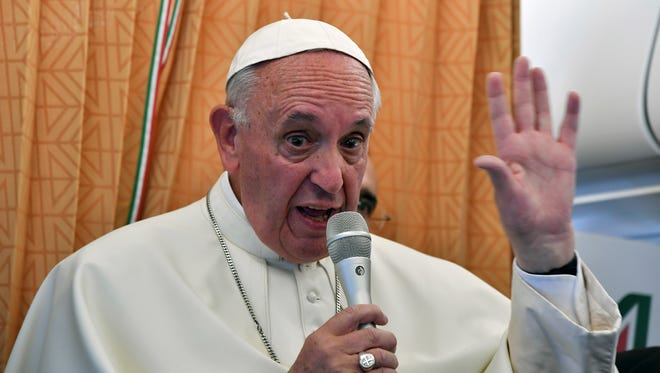 Pope Francis talks to journalists during a press conference he held on board the airplane on his way back to the Vatican, at the end of three-day visit to Armenia, Sunday, June 26, 2016. (Tiziana Fabi/Pool photo via AP)