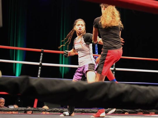 Shadow Hills freshman girls wrestler Caitlin Cardenas, left, competes in a mixed martial arts match. Cardenas got her start in the sport of grappling at the age of six through jujitsu and judo, but she just recently took up wrestling months ago.
