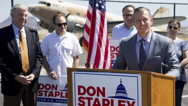 Republican Bryan Martyn announces he is dropping out of the 5th District race and endorsing his primary opponent Don Stapley, far left, during a press conference at Commemorative Air Force Airbase in Mesa on May 13, 2016.