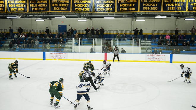Essex and BFA face off during the boys hockey game between the BFA St. Albans Bobwhites and the Essex Hornets at the Essex Skating Facility on Wednesday night.