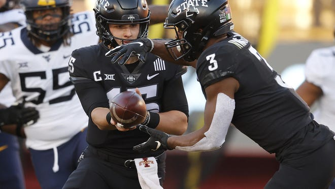 Iowa State quarterback Brock Purdy, left, hands off to Iowa State running back Kene Nwangwu during the first half of an NCAA college football game against West Virginia, Saturday, Dec. 5, 2020, in Ames, Iowa.