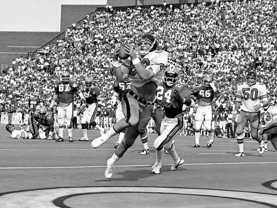 Vanderbilt star tight end Barry Burton (89) grabs the two-point conversion pass from quarterback David Lee (8), left on his back. Burton got behind Florida defender Alvin Cowans (24) at Dudley Field Oct. 12, 1974.