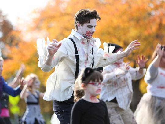 Casey Gill and dozens of Salem residents, clad in zombie