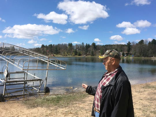 In this April 21, 2017 photo, Cris Van Houten explains how the shoreline of Huron Lake, has receded over the years in Oasis, WI. Van Houten and other central Wisconsin lake property owners insist a proliferation of high-capacity wells are draining the region's lakes.