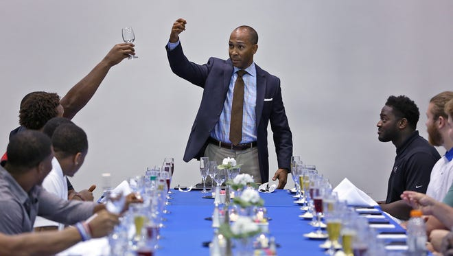 James Payne offers tips  about dining etiquette to Colts rookies Monday at the Lucas Estate, including which glass to choose and how to hold it.
