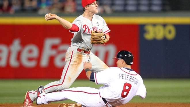 Phillies second baseman Chase Utley (26) turns a double play Monday against the Atlanta Braves in the ninth inning at Turner Field. Credit: Brett Davis-USA TODAY Sports