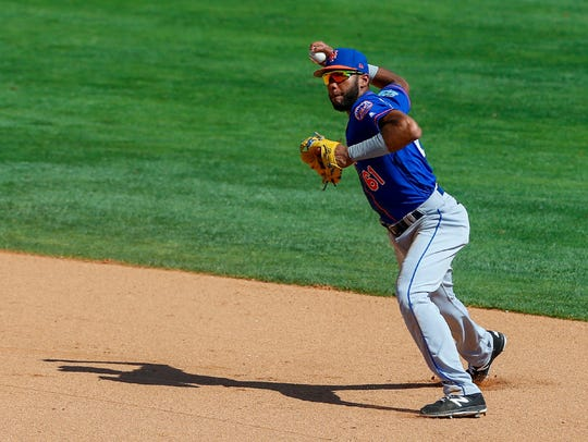 Amed Rosario prepares to throw to first.