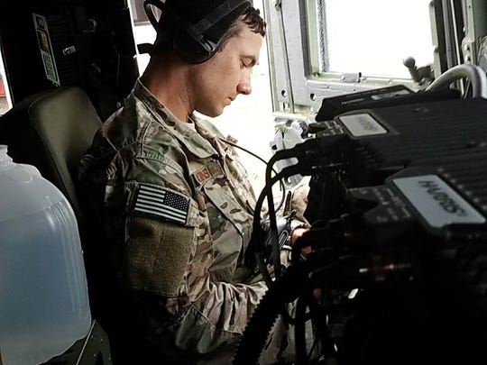 Louisiana National Guardsmen with the 122nd Aviation Support Operations Squadron, headquartered in Pineville, assist the U.S. Coast Guard with establishing aviation communications during search-and-rescue operations in Sulfur, Louisiana, Aug. 30, 2017.