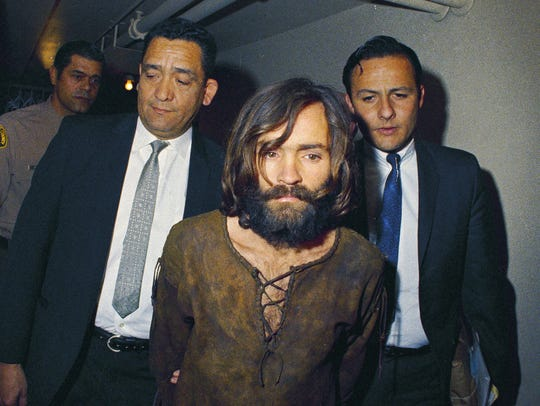 In this 1969 file photo, Charles Manson is escorted