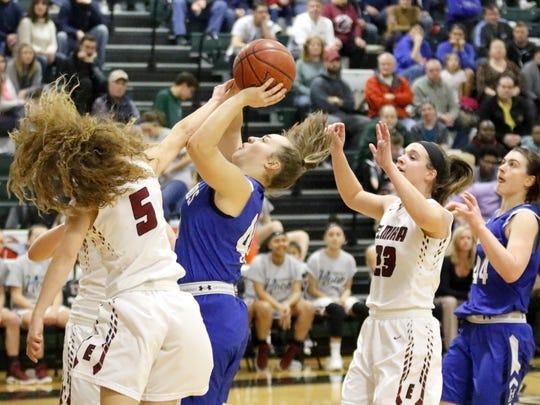 Tess Cites of Horseheads puts up a shot as Parker Moss (5) of Elmira tries to block it Jan. 29 at Elmira High School.