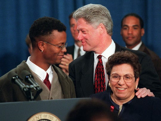 President Clinton greets HIV-positive activist Sean